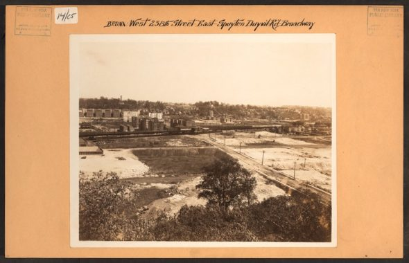 """1924 image West 238th Street in Riverdale facing east towards Broadway were you can see the 1 subway line running through mostly empty lands to the west of Broadway. The photographer noted the landfills being prepped for """"extensive real estate development"""". A lot of this development which occurred throughout The Bronx was in fact due to the expansion of the subway system throughout our borough. Image Credit: Irma and Paul Milstein Division of United States History, Local History and Genealogy, The New York Public Library. """"Bronx: 238th Street (West) - Spuyten Duyvil Road"""" The New York Public Library Digital Collections. 1926."""