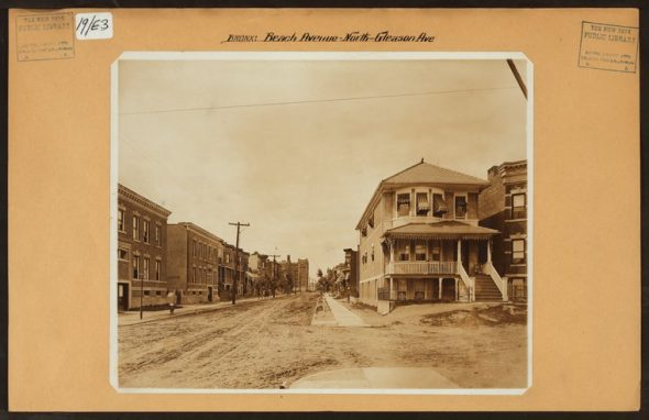 """Beach Avenue looking north at Gleason Avenue in Soundview in 1915. At the end of the street you can see PS 47 which still stands but today would barely be visible from this same vantage point as the 6 train obscures the view. Image Credit: Irma and Paul Milstein Division of United States History, Local History and Genealogy, The New York Public Library. """"Bronx: Beach Avenue - Gleason Avenue"""" The New York Public Library Digital Collections. 1915."""