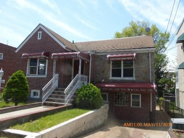 1016 E 218th Street in Williamsbridge is a foreclosed property being sold / Image via Realtor.com