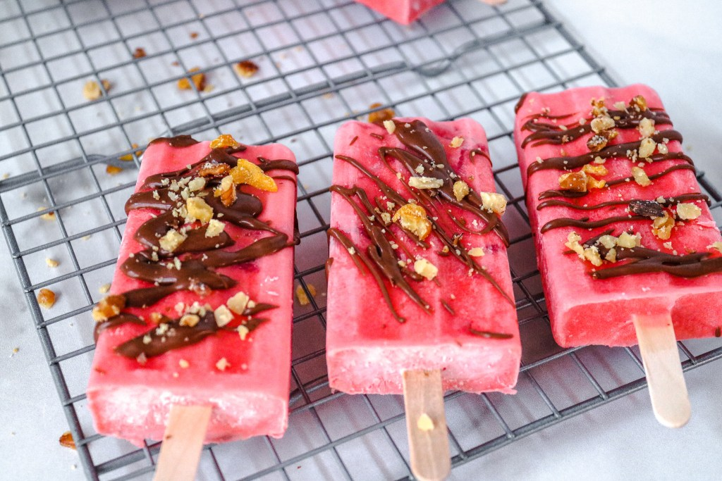 Keto Strawberry Popsicles on a wire reack