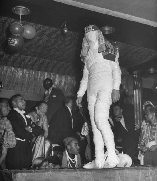 1949 – Contestants parading for judges for the costume prize during the Urban League Ball at the Savoy Ballroom in February 1949. Source: photo by Yale Joel for LIFE Magazine.