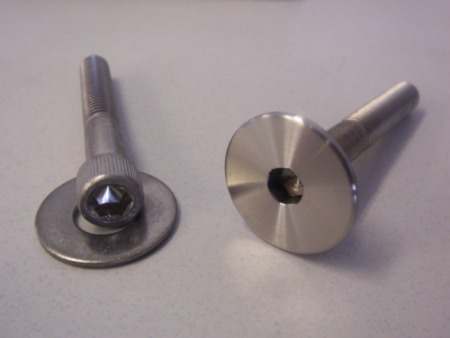 I welded stainless washers to stainless allen head cap screws for the body mount bolts.