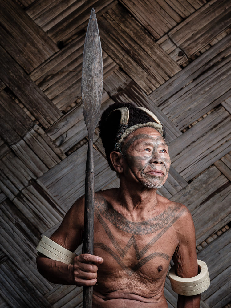 A Konyak Warrior with his Facial Tattoo - Nagaland, India