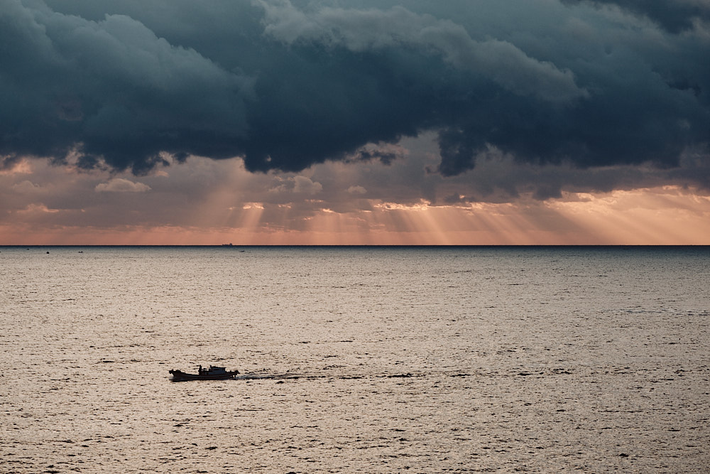 A Fishing Boat Returns to Port at Sunrise