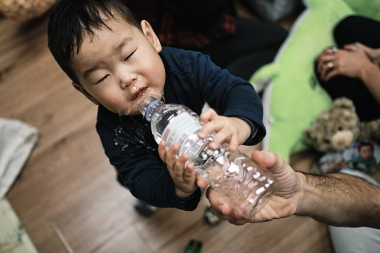 Adoption first meeting in Seoul - Trying to Drink Water