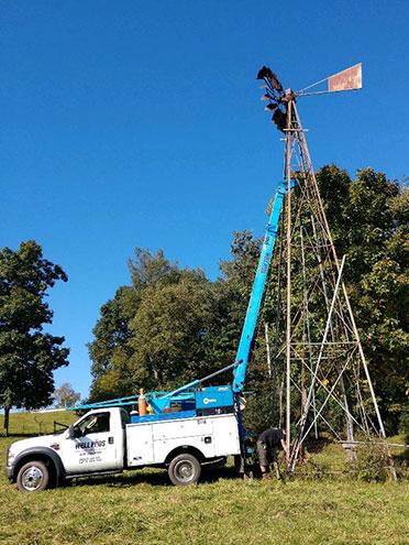 Well Pros truck near windmill tower