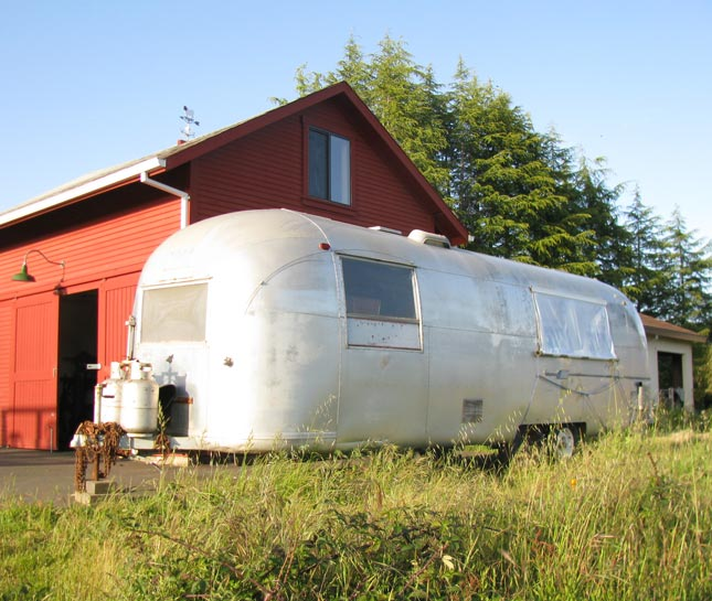 By one of the barns on the property, a choice vintage Airstream is undergoing its own renewal as the weary interior is replaced with custom-built everything.