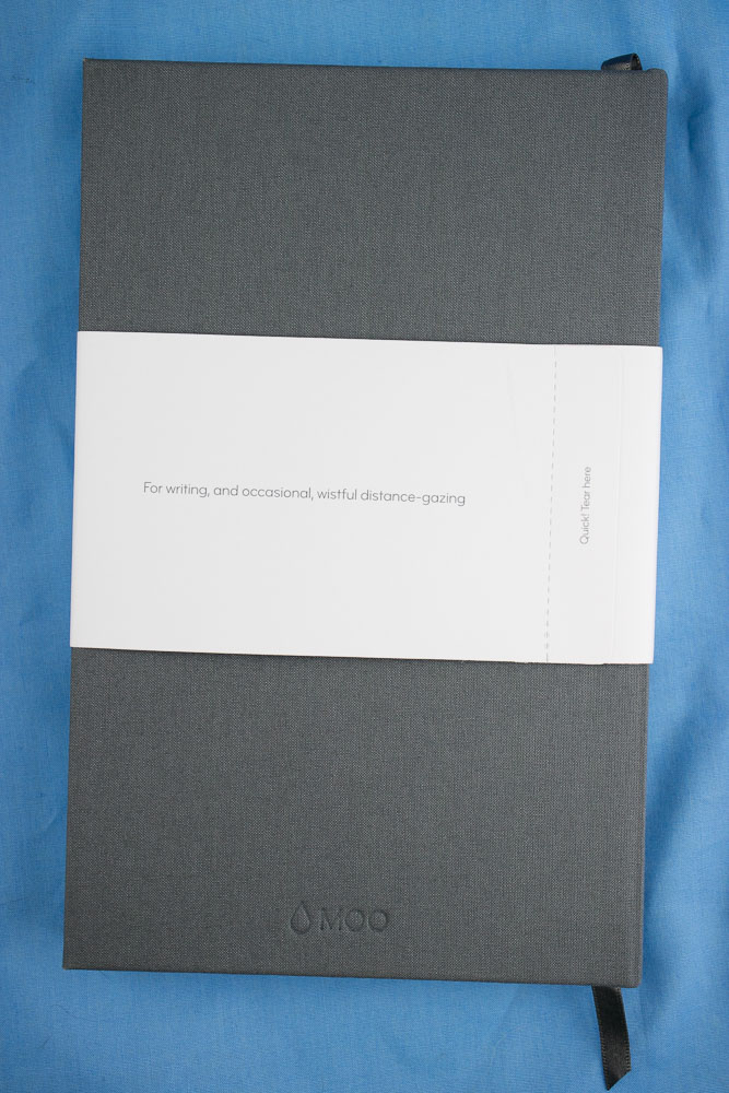 Tear and remove bellyband on Moo Notebook