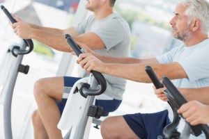 Men using exercise bikes
