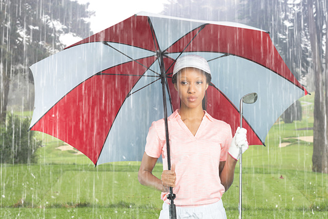 Women Golfer in the Rain