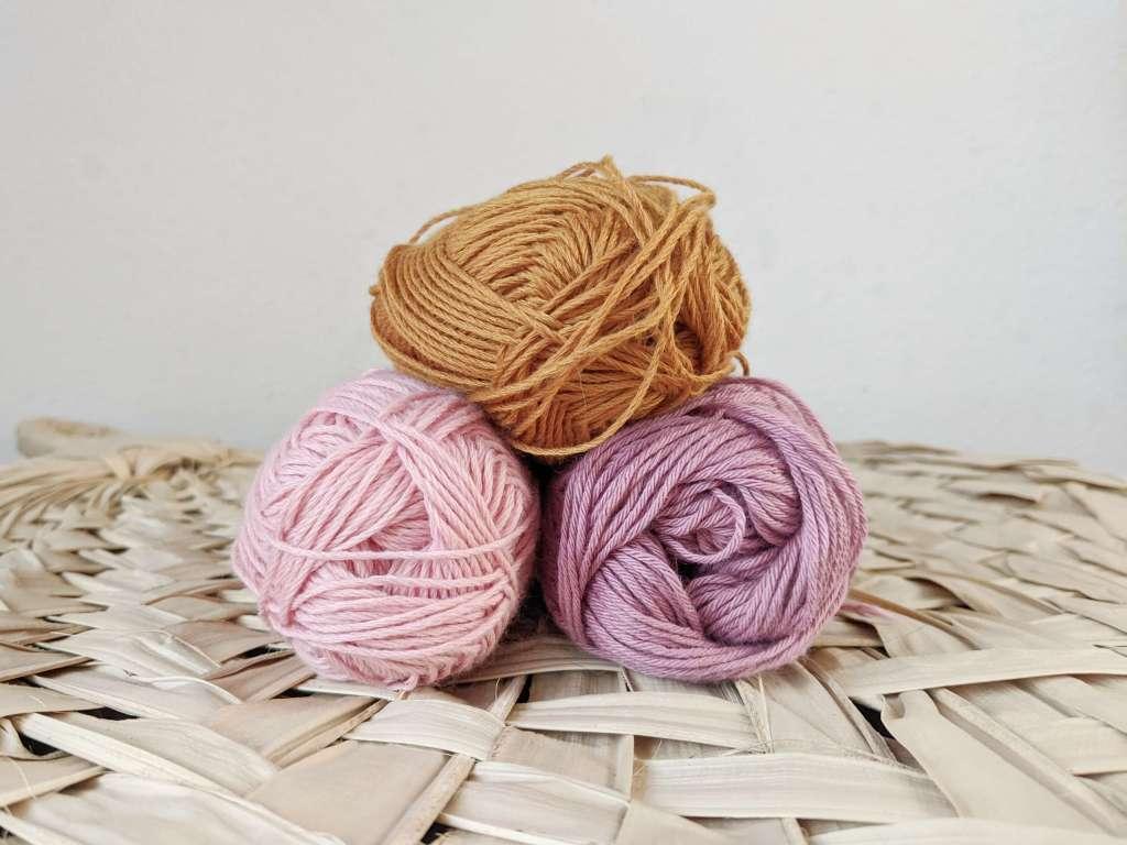 Montessori Elementary School quiet time activities: Yarn weaving