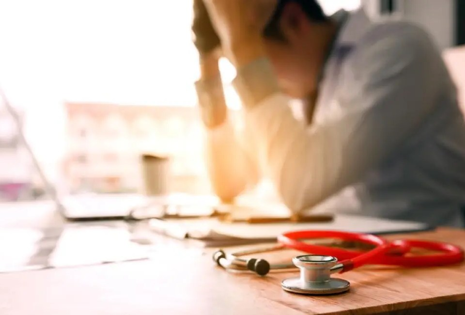 3 Common Pain Points in Healthcare Practices 16 Exhausted Doctor