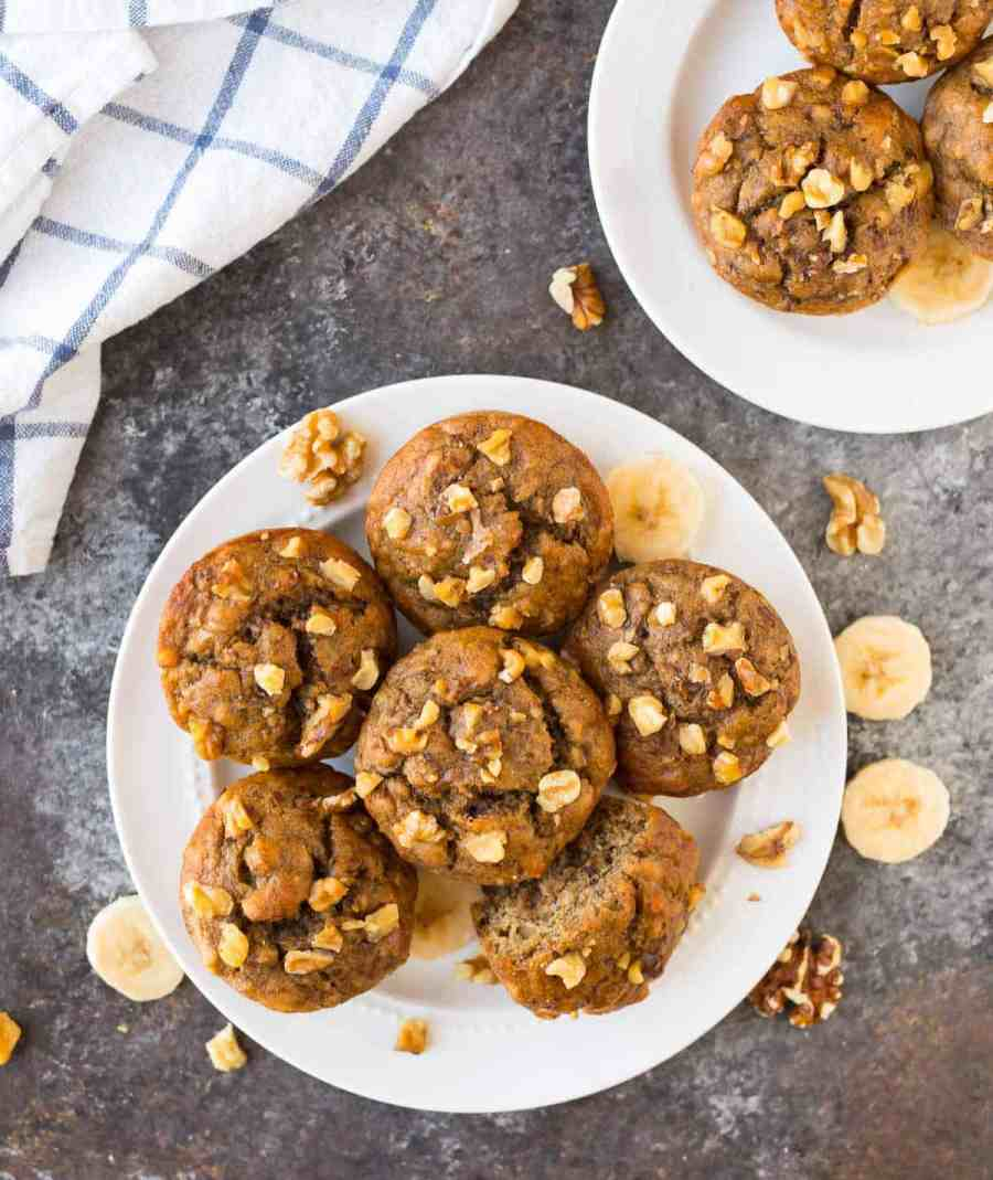 Healthy banana nut muffins on a white plate