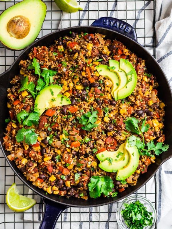 healthy Mexican quinoa in a skillet with avocado