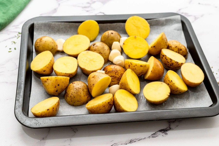 Chopped potatoes on a sheet pan