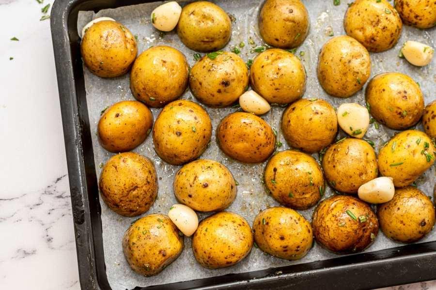 Potatoes and garlic on a sheet pan