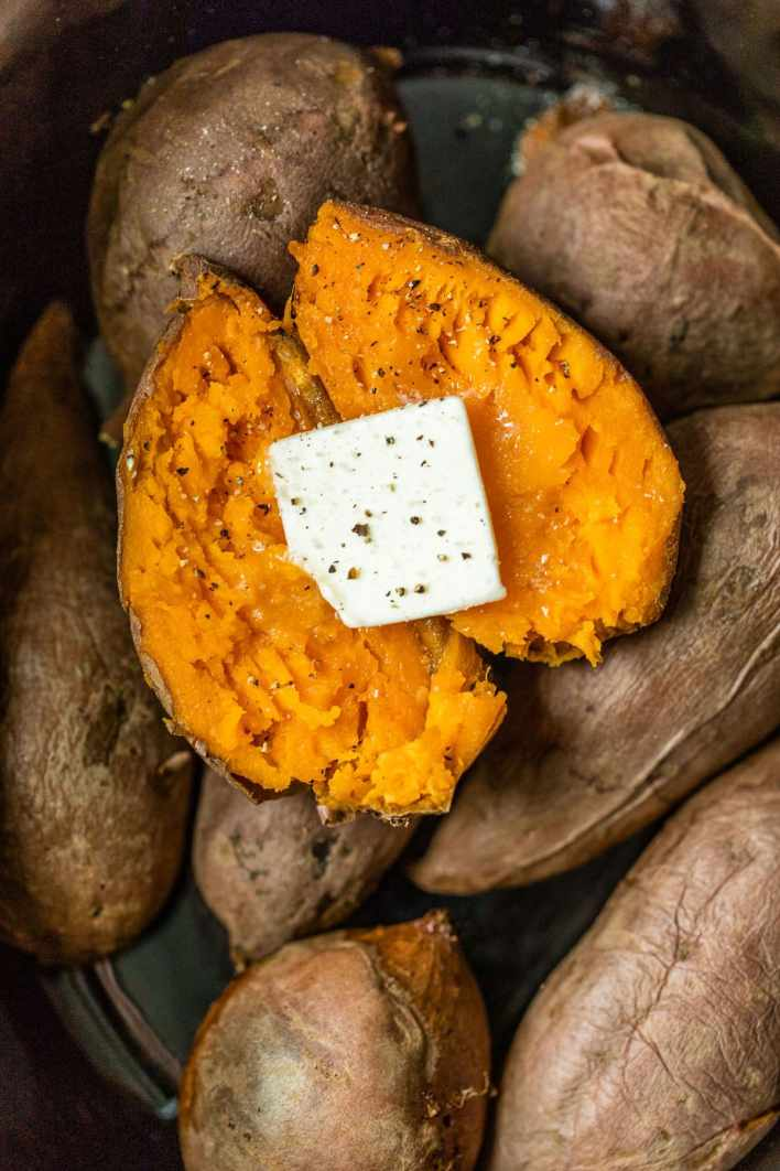 A sweet potato cut open with butter