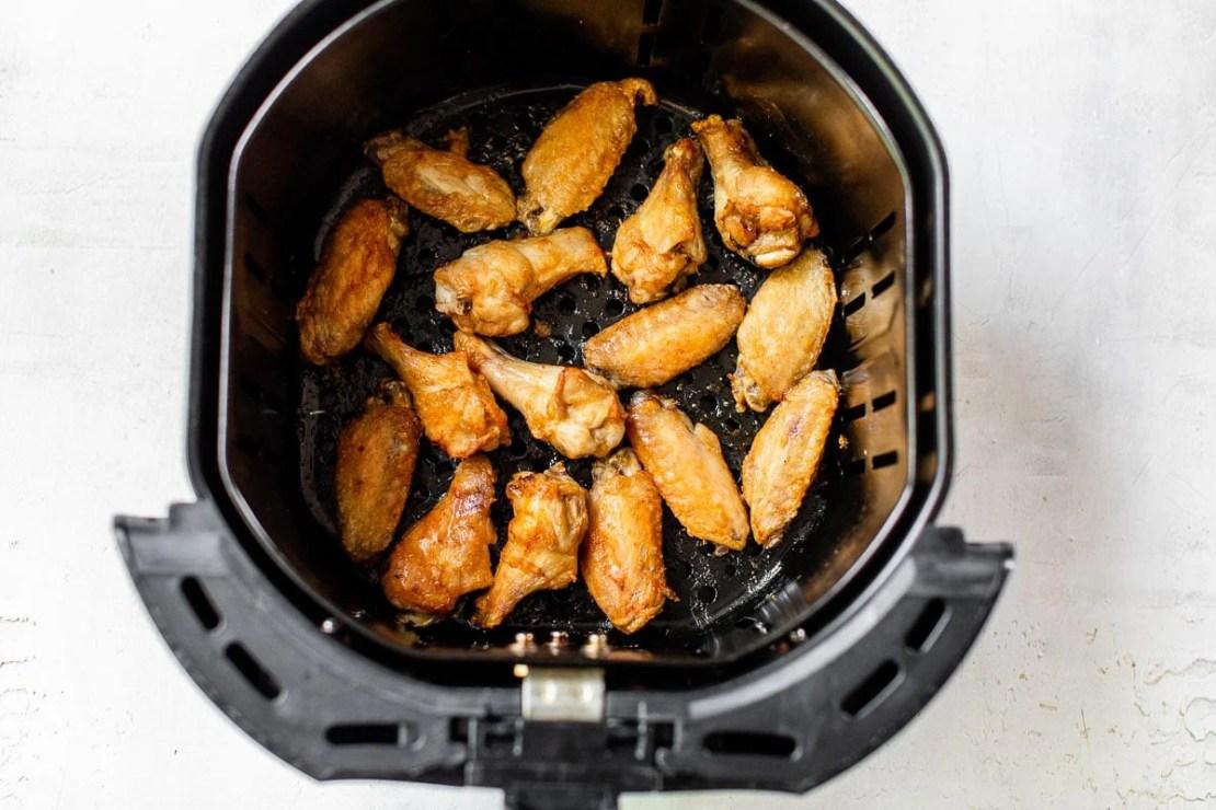 air fryer chicken wings spread in basket