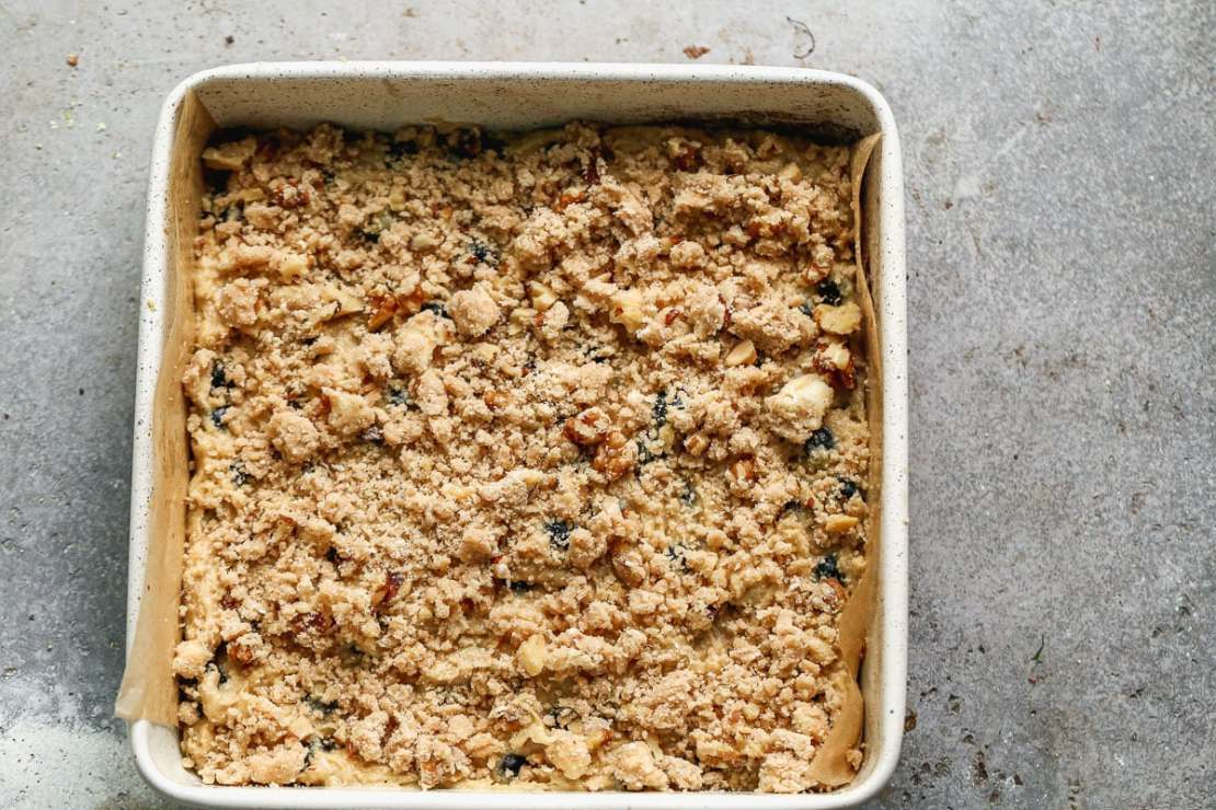 blueberry buckle with walnuts in baking pan