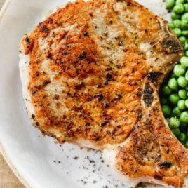 oven stuffed bone in pork chops on a plate