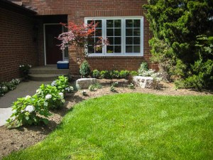 landscape Burlington entrance stone work with garden design