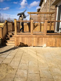 landscape Oakville wooden deck with metal railing