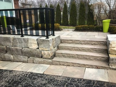 landscape burlington stone steps and deck with metal fence