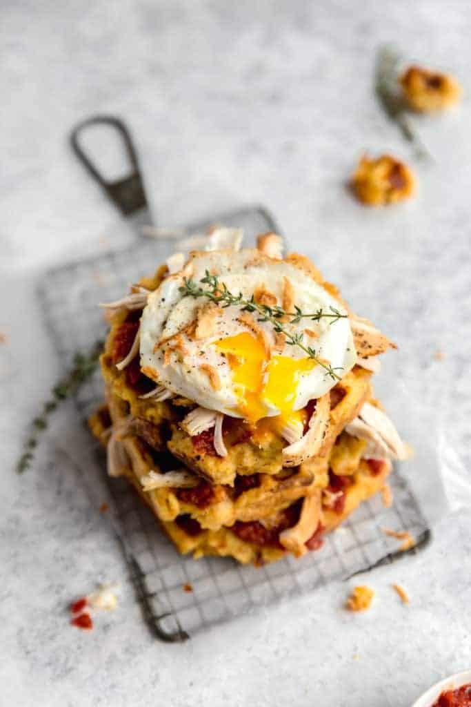 cornbread stuffing waffles with tomato jam, turkey, crispy onions, and a fried egg!