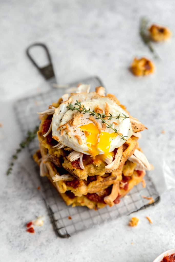 cornbread stuffing waffles with tomato jam, turkey, crispy onions, and a fried egg!