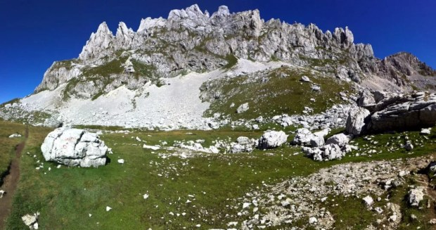 The trail weaves below towering granite peaks</center.