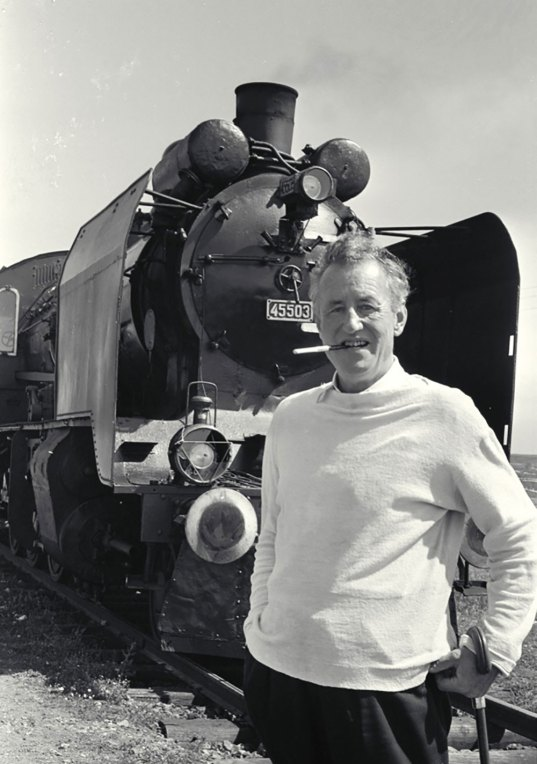 Director Ian Flemming is posing in front of the Orient Express train
