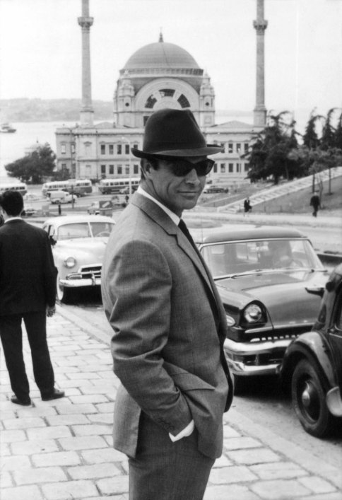 Sean Connery is standing on an Istanbul hilltop overlooking the Bosphorus. The mosque is located right next to the Dolmabahçe Palace.