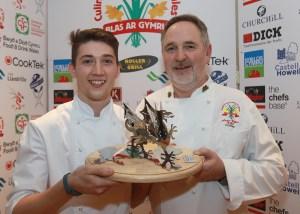 Sion Hughes recieves his trophy from Arwyn Watkins