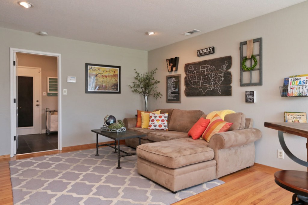 industrial family room with wall collage