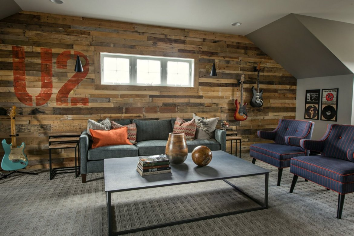 industrial living room with reclaimed wood wall