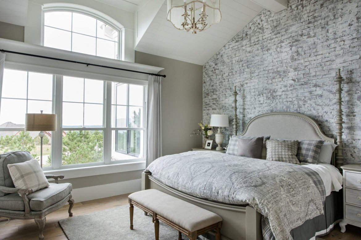 bedroom with white washed brick