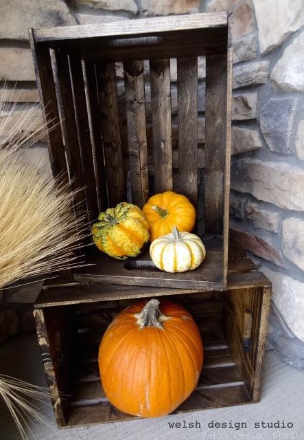 fall decorations stained crates with pumpkins and wheat