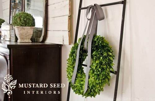 boxwood wreath on ladder miss mustard seed