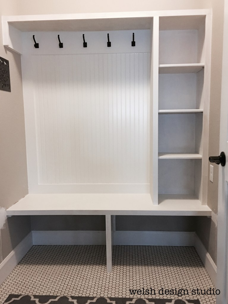custom mudroom makeover with bench and shelves