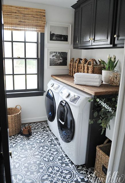 laundry room black cabinets and tile