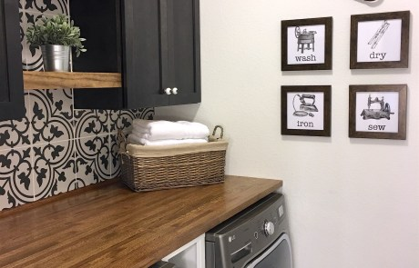laundry room with patterned tile