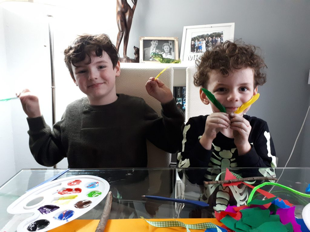 Two boys doing crafts