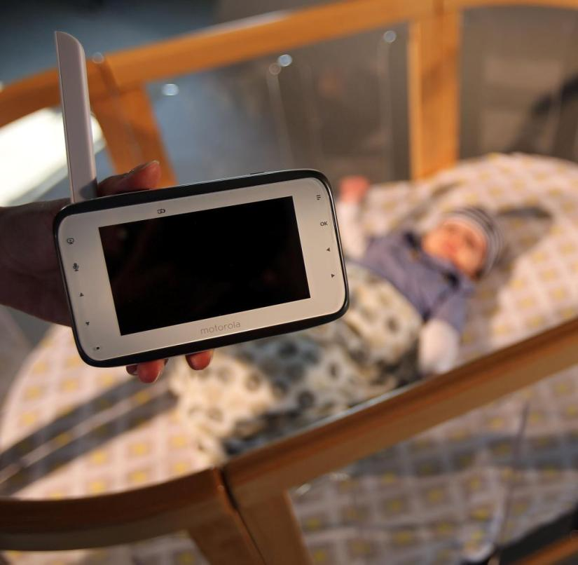 Sleeping baby and video baby monitor