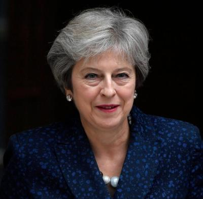 Theresa May: May warns EU not to treat UK unfairly in ...