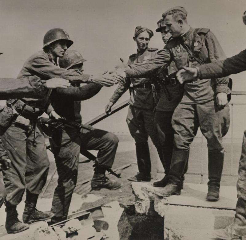 'Soviet and American troops meeting a Torgau on the Rhine, April 2, 1945. World War II.' | Use worldwide