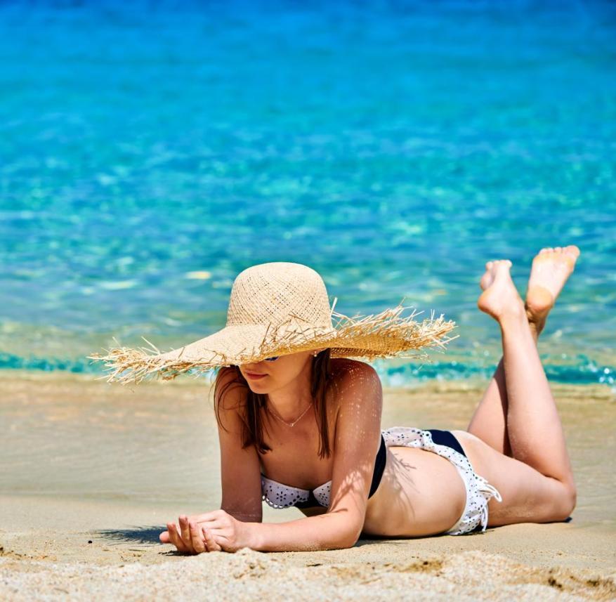Woman in bikini on beach, Sithonia, Greece   Use worldwide