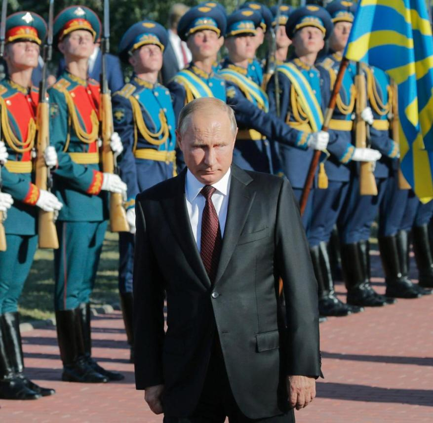Narrowed look: Vladimir Putin, here inspecting an honor guard, omits unpleasant episodes of Russian war history in his essay