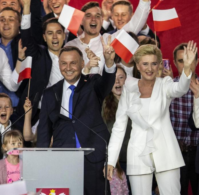 Symbol of a divided world: the reelected Polish President Andrzej Duda with his wife