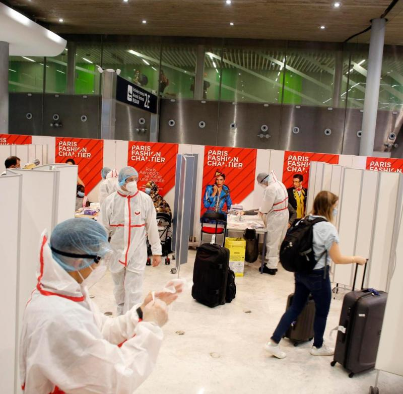 A passenger leaves after being tested with a COVID-19 test, at the Roissy Charles de Gaulle airport, outside Paris, Saturday, Aug. 1, 2020. Travelers entering France from 16 countries where the coronavirus is circulating widely are having to undergo virus tests upon arrival at French airports and ports.(AP Photo/Thibault Camus)