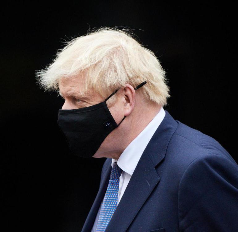 Britain's Prime Minister Boris Johnson visits the headquarters of Octopus Energy, in London, Britain October 5, 2020. Leon Neal/Pool via REUTERS